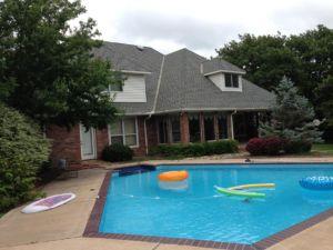 slate asphalt on home with pool